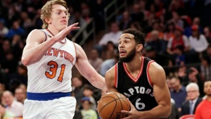 In this April 9, 2017, file photo, Toronto Raptors' Cory Joseph, right, drives past New York Knicks' Ron Baker during the first half of an NBA basketball game in New York. (File/ THE ASSOCIATED PRESS)