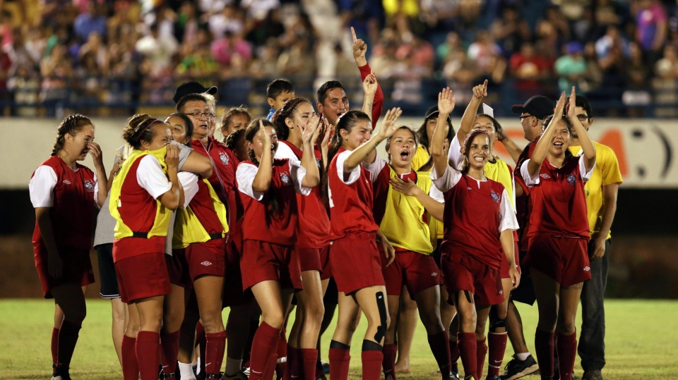 Indigenous players from Canada celebrate the victory against Brazil's Xerentes team, during a soccer game at the World Indigenous Games in Palmas, Brazil, Friday, Oct. 30, 2015. (AP Photo/Eraldo Peres)