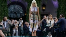 Italian fashion designer Donatella Versace acknowledges the applause of the audience at the end of the Versace men's Spring-Summer 2018 collection, that was presented in Milan, Italy, Saturday, June 17, 2017. (Luca Bruno/AP Photo)