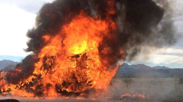 Flames envelop a motorhome on the shoulder of the Trans-Canada Highway, near the Highway 40 overpass, on Saturday afternoon (photo: Elyse Demers)
