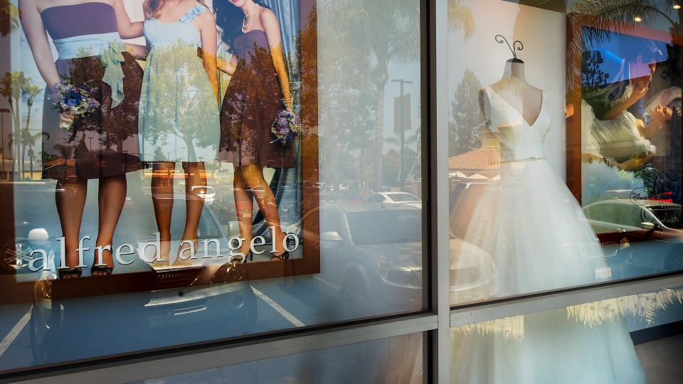 A window display is seen at Alfredo Angelo bridal store in West Covina, Calif., Friday, July 14, 2017. (Walt Mancini /Los Angeles Daily News via AP)