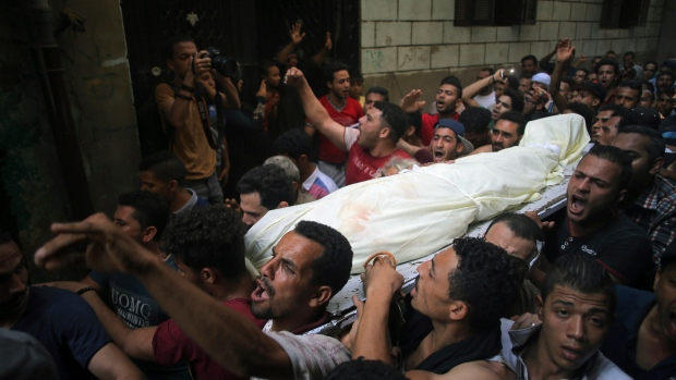 People carry the body of Sayed Tafshan, who died during clashes between security forces and residents of al-Waraq island, on the southern fringes of Cairo, Egypt, Sunday, July 16, 2017.  (AP Photo/Mostafa Darwish)