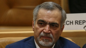 In this picture taken on Monday, July 3, 2017, Hossein Fereidoun, brother and top aide of moderate Iranian President Hassan Rouhani sits in a conference in Tehran, Iran. (AP Photo/Vahid Salemi)