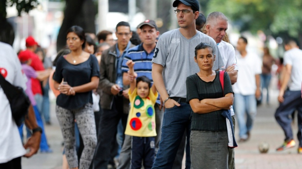 Venezuelan line up outside polling statio