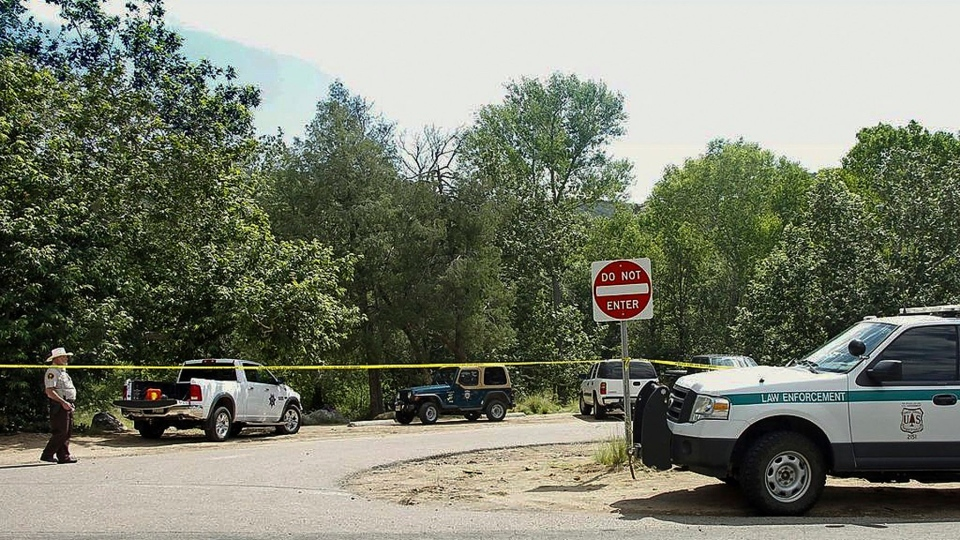 The Water Wheel Campground parking lot is blocked off by authorities in the Tonto National Forest, Ariz., on Sunday, July 16, 2017. (Alexis Bechman/Payson Roundup via AP)