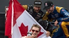 Winner Josef Newgarden, centre, second place finisher Alexander Rossi, left, and third place finisher James Hinchcliffe pose on the podium following the Honda Indy Toronto in Toronto on Sunday, July 16, 2017. (Frank Gunn / THE CANADIAN PRESS)