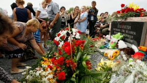 Local residents lay flowers at MH17 memorial