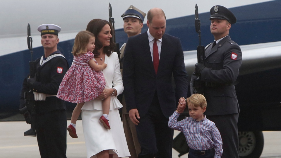 Kate, the Duchess of Cambridge holding Princess Charlotte walks with Prince William and Prince George as they arrive at the airport, in Warsaw , Poland, Monday, July 17, 2017. (AP Photo/Czarek Sokolowski)