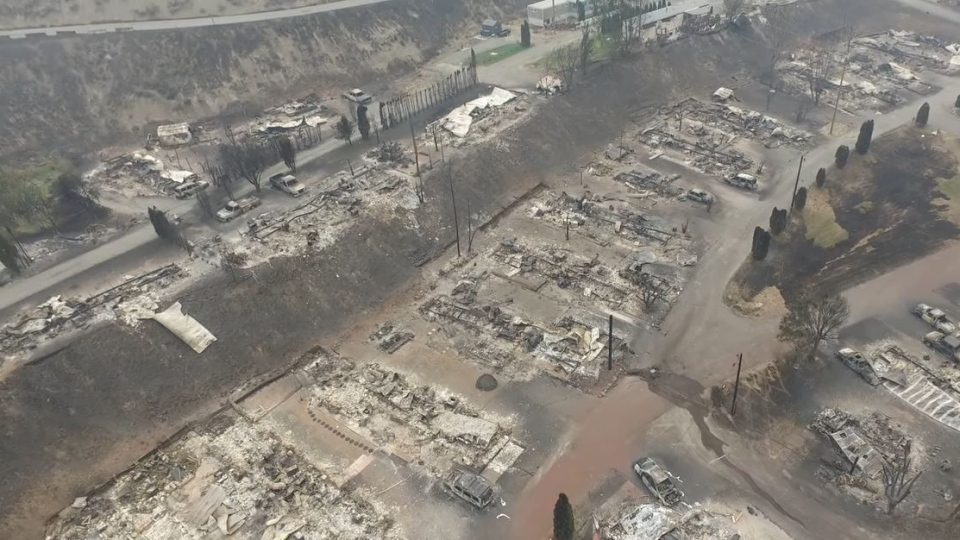 The drone footage shows flattened homes, burnt-out cars and charred lands in the Boston Flats community.