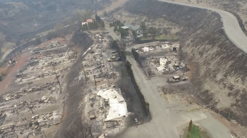 The footage was shot on Tuesday, a few days after a wildfire ripped through dozens of homes in the small mobile home development on July 7.