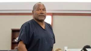 O.J. Simpson returns to the witness stand to testify after a break during an evidentiary hearing in Clark County District Court in Las Vegas on May 15, 2013. (AP / Julie Jacobson)