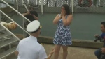 Sub-lieutenant Tristan Lapointe proposes to Gabrielle Lambert after HMCS St. John's arrives in Halifax on Monday, July 17, 2017. (CTV Atlantic)