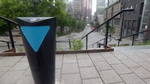 A blue arrow points toward the St. Lawrence river on the Mountain-River promenade in Montreal