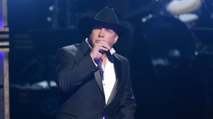 In this Nov. 2, 2016 file photo, Garth Brooks performs at the 50th annual CMA Awards in Nashville, Tenn. (Photo by Charles Sykes/Invision/AP, File)