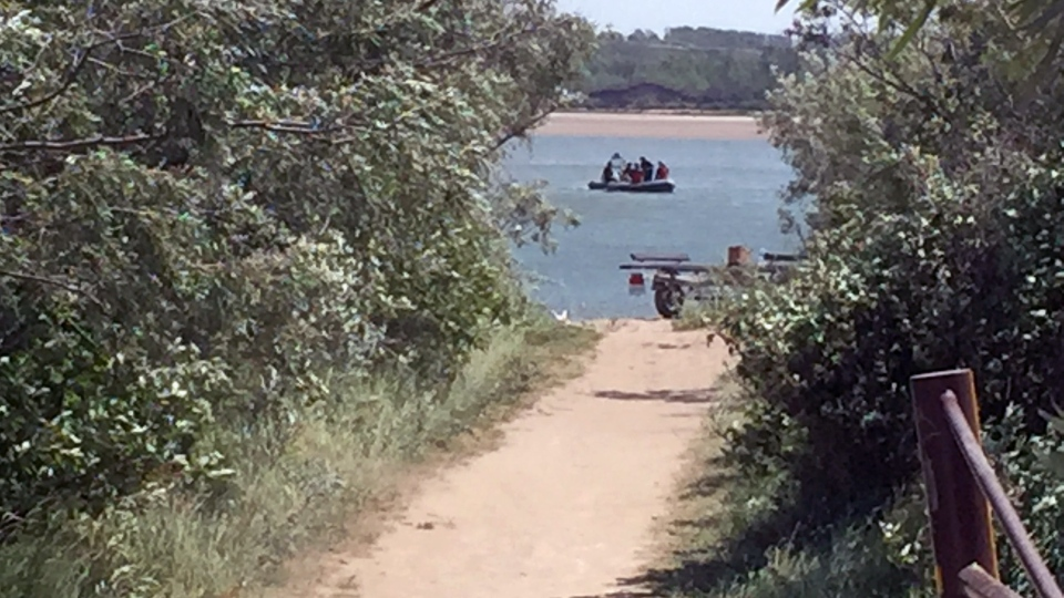 Emergency crews search the South Saskatchewan River, just south of Saskatoon, for a missing 17-year-old swimmer Monday, July 17, 2017. (Mark Villani/CTV Saskatoon)