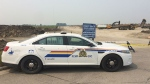 An RCMP cruiser blocks the area near Okotoks where human remains were discovered on Monday, July 17, 2017.