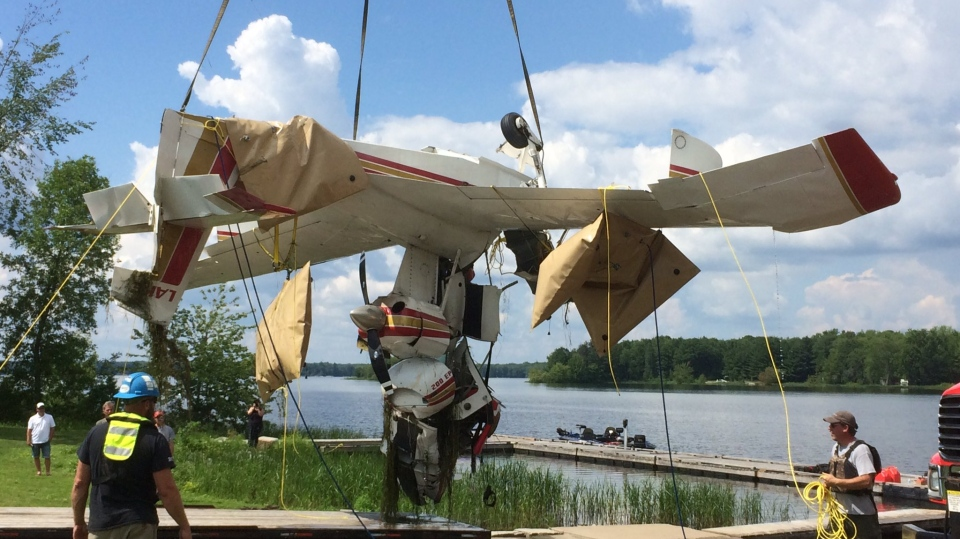 The wreckage of a small plane is hoisted out of Lake St. John in Ramara Township, Ont. on Monday, July 17, 2017. (Aileen Doyle/ CTV Barrie)