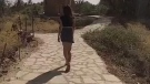 The unidentified woman in a miniskirt is seen in an image from video that caused controversy in Saudi Arabia. (source: Facebook / هشام التميمي)