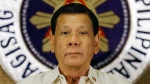 Philippine President Rodrigo Duterte stands in front of the presidential seal during a ceremony with the Armed Forces of the Philippines at the Malacanang presidential palace in Manila, Philippines, Tuesday, July 18, 2017. (AP / Aaron Favila)