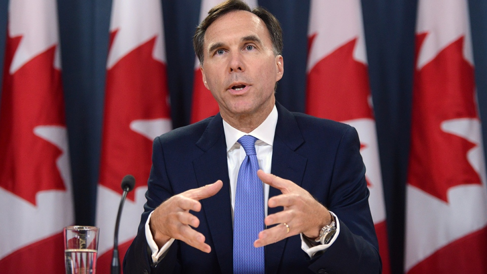 Minister of Finance Bill Morneau holds a press conference at the National Press Theatre in Ottawa on Tuesday, July 18, 2017. (Sean Kilpatrick / THE CANADIAN PRESS)