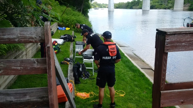 Emergency crews searched the Rideau River after a young man swimming with friends went into distress and slipped beneath the surface on Tuesday, July 18, 2017. His body was later recovered.  (Ottawa Paramedic Service)