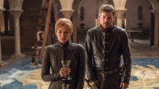 """This image released by HBO shows Lena Headey, left, and Nikolaj Coster-Waldau in """"Game of Thrones."""" (Helen Sloan/HBO via AP)"""