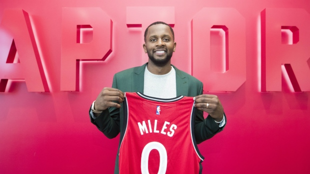 Newly acquired Toronto Raptors player C.J. Miles poses with his jersey in Toronto on Tuesday, July 18, 2017. (Mark Blinch / THE CANADIAN PRESS)