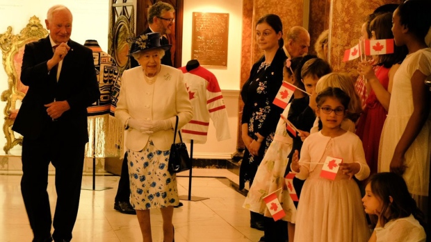 Canadian official touches queen, defends protocol breach