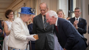 Queen Elizabeth II talks with Canada Governor General David Johnston at Canada House in Trafalgar Square, central London, Wednesday July 19, 2017, marking the 150th anniversary of Canada's Confederation. (Stefan Rousseau/PA via AP)