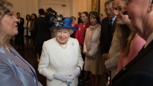 Britain's Queen Elizabeth II meets with guests at Canada House in Trafalgar Square, central London, Wednesday July 19, 2017, marking the 150th anniversary of Canada's Confederation. The queen will meet various dignitaries and guests during her visit to celebrate the establishment of modern Canada 150-years ago. (Stefan Rousseau/PA via AP)