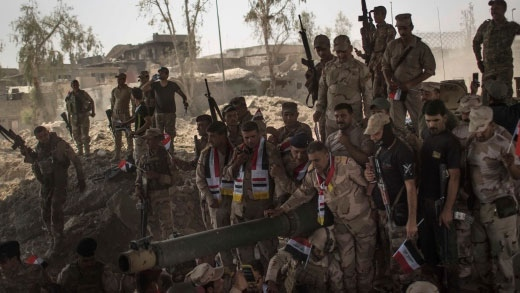 Iraqi Army soldiers gather to celebrate their gains as their fight against Islamic State militants continues in the Old City of Mosul, Iraq, Sunday, July 9, 2017. (AP / Felipe Dana)