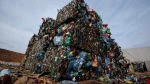 FILE - In this March 12, 2015 file photo, plastic trash is compacted into bales ready for further processing at the waste processing dump on the outskirts of Minsk, Belarus.  (AP Photo/Sergei Grits)