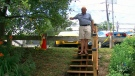 Adi Astl stands on the stairs he built in Tom Riley Park, in Etobicoke, Ont., on July 19, 2017.