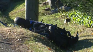 A 19-year-old woman was taken to hospital after crashing her motorcycle into a utility pole on Cadboro Bay Road early Wednesday morning. July 19, 2017. (CTV Vancouver Island)