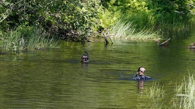 Quebec police divers search a creek in the Kitigan Zibi reserve on Wednesday, July 19, 2017 for two teenage girls, Maisy Odjick and Shannon Alexander,  who went missing September 5th, 2008. (Sûreté du Québec)