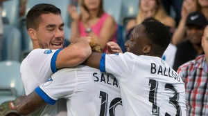 Montreal Impact's Michael Salazar (19) is smothered by teammates after scoring against the Philadelphia Union during first half MLS soccer action in Montreal on Wednesday, July 19, 2017. THE CANADIAN PRESS/Peter McCabe