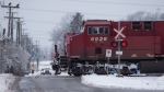 A Canadian Pacific Railway train passes through a crossing on a rural road in Delta, B.C., on Sunday February 5, 2017. (Darryl Dyck/The Canadian Press)