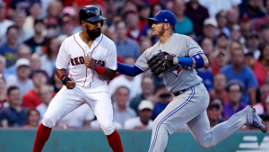 Toronto Blue Jays third baseman Josh Donaldson, right, tags out Boston Red Sox's Chris Young as he was caught off the base while trying to advance during the second inning of a baseball game at Fenway Park in Boston, Wednesday, July 19, 2017. (AP Photo/Charles Krupa)