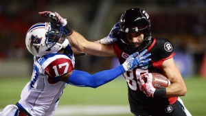 Ottawa Redblacks wide receiver Brad Sinopoli (88) fends off a tackle from Montreal Alouettes defensive back Brandon Stewart (17) during second half CFL football action in Ottawa on Wednesday, July 19, 2017. THE CANADIAN PRESS/Sean Kilpatrick