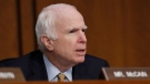 FILE - In this June 8, 2017, file photo, Sen. John McCain, R-Ariz., questions former FBI Director James Comey during a Senate Intelligence Committee hearing on Capitol Hill in Washington. Doctors say McCain has a brain tumor associated with a blood clot that was removed last week. In a statement late Wednesday, July 19, 2017, doctors reveal that McCain has been diagnosed with glioblastoma, an aggressive cancer. (AP Photo/Alex Brandon, File)