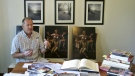 In Martin Kober displays literature and copies of a family heirloom that he believes was painted by Renaissance master Michelangelo, at his home in Tonawanda, N.Y. on June 26, 2017. (AP / Carolyn Thompson)