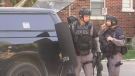 Tactical officers respond to man barricaded in a unit of a north London high rise on Thursday, July 19, 2017. (CTV London)