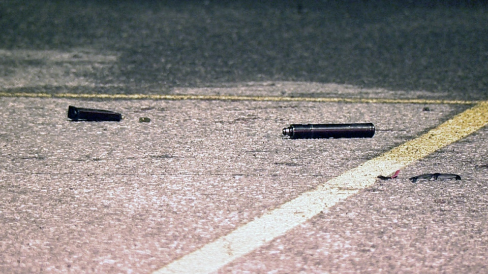 The loaded magazine, a bullet, and a silencer were lying on the ground in a parking lot in Boucherville (CTV Montreal/Cosmo Santamaria)