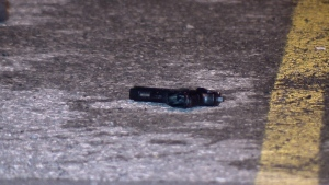 Passersby spotted the semi-automatic pistol lying on the ground in the 2020 Boucherville mall parking lot (CTV Montreal/Cosmo Santamaria)