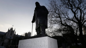 A bronze statue of Britain's World War II leader Sir Winston Churchill, by sculptor Ivor Roberts-Jones, stands in Parliament Square, London, Friday, Jan. 23, 2015. (AP Photo/Tim Ireland)
