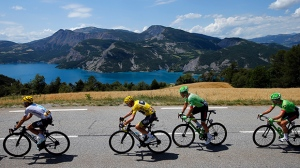 From left, Spain's Mikel Landa, Britain's Chris Froome, wearing the overall leader's yellow jersey, Netherland's Dylan van Baarle, and New Zealand's Patrick Bevin ride during the eighteenth stage of the Tour de France cycling race over 179.5 kilometers (111.5 miles) with start in Briancon and finish on Izoard pass, France, Thursday, July 20, 2017. (AP Photo/Peter Dejong)