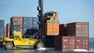 A container is hoisted from a stack in the Port of Montreal, on Jan. 4, 2016. (Graham Hughes / THE CANADIAN PRESS)
