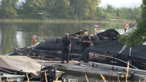 Fuel spill after boats catch on fire