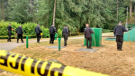 Uniformed officers conduct a grid search of Central Park in Burnaby, B.C., after the death of 13-year-old Marissa Shen. July 20, 2017. (CTV/Ben Miljure)