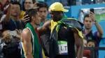 Usain Bolt, right, and Wayde Van Niekerk at the Olympic stadium in Rio de Janeiro, Brazil, on Aug. 14, 2016. (Julio Cortez / AP)